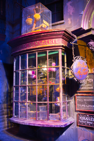 dark alley: Leavesden, London, UK - 1 March 2016: Magic shops  windows display in Diagon Alley from Harry Potter film. Warner Brothers Studio Editorial