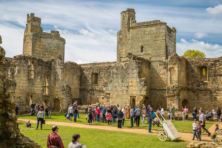 keep: BODIAM, UK - 1 MAY, 2016: Inner view of Bodiam Castle 14th-century moated fortification with lots of tourists.