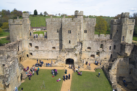 BODIAM, UK - 1 MAY, 2016: Inner view of Bodiam Castle 14th-century moated fortification with lots of tourists.