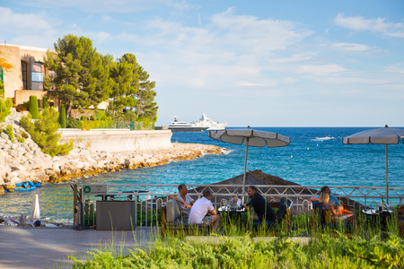 Monaco, Monte Carlo - September 15, 2016: Le Meridien Beach Plaza hotel view with people enjoying holidays. Editorial