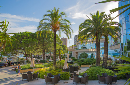monte carlo: Monaco, Monte Carlo - September 15, 2016: Le Meridien Beach Plaza hotel view with palms against of blue sky