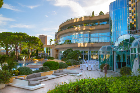le: Monaco, Monte Carlo - September 15, 2016: Inner garden of the Le Meridien Beach Plaza hotel view with people enjoying holidays. Editorial