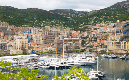 principality: Monaco, Monte Carlo - September 16, 2016: Principality of Monaco. View of the seaport and the city of Monte Carlo with luxury yachts and sail boats