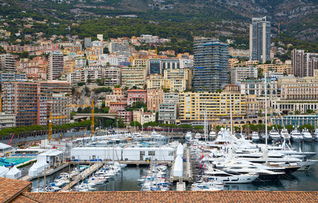 16: Monaco, Monte Carlo - September 16, 2016: Principality of Monaco. View of the seaport and the city of Monte Carlo with luxury yachts and sail boats
