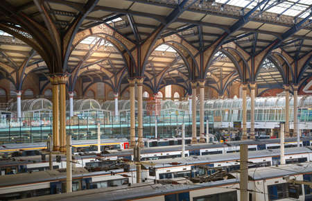 depart: LONDON, UK - 17 May, 2016: Liverpool street train station historical interior with trains ready to depart.