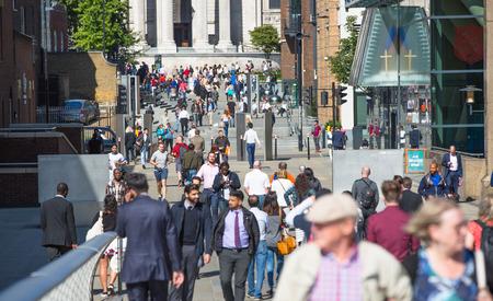 british touring car: LONDON, UK - SEPTEMBER 10, 2015: Millennium bridge with walking people