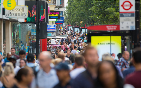 street life: London, UK - August 24, 2016: Lots of people walking in Oxford street, the main destination of Londoners for shopping. Modern life concept Editorial