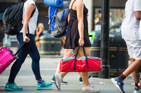cross legs: London, UK - August 24, 2016: Lots of people walking in Oxford street, the main destination of Londoners for shopping. Modern life concept Editorial
