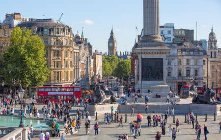 trafalgar: LONDON, UK - SEPTEMBER 10, 2015: Lots of people at the Trafalgar square in the hot sunny day