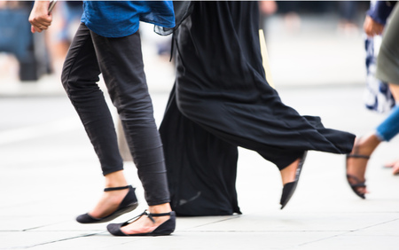 street life: Feet of pedestrians walking on the crosswalk in Oxford street, London. Modern life, travel and shopping concept