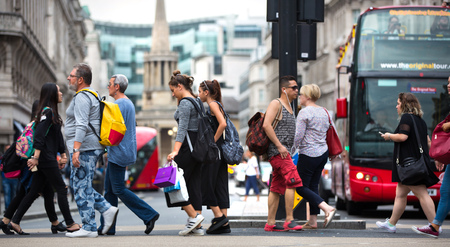 London, UK - August 24, 2016:  Lots of people crossing the Regent street at the traffic lights. Populated city concept Editorial