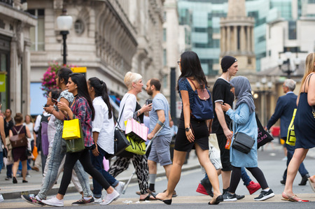 populated: London, UK - August 24, 2016:  Lots of people crossing the Regent street at the traffic lights. Populated city concept Editorial