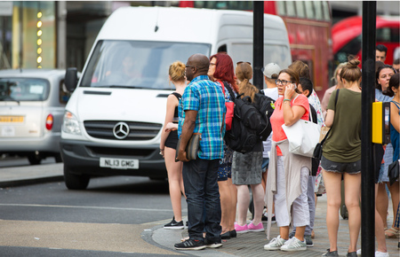 regent: London, UK - August 24, 2016:  Lots of people crossing the Regent street at the traffic lights. Populated city concept Editorial