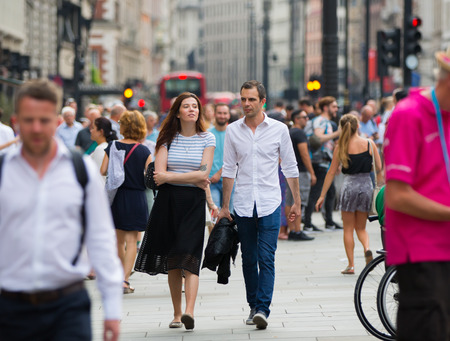 London, UK - August 24, 2016:  Young couple walking in the Leicester square Editorial