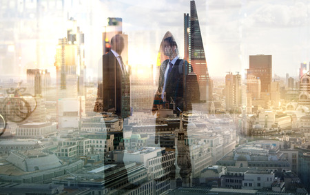 personas trabajando en oficina: Two businessman in the City. Business and modern life concept. Multiple  exposure image Foto de archivo