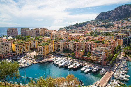 Monaco, Monte Carlo - September 16, 2016: View of the marina with luxury yachts and residential development