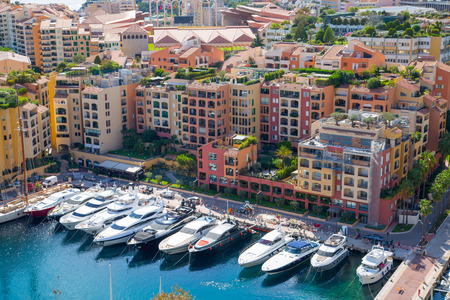 16: Monaco, Monte Carlo - September 16, 2016: View of the marina with luxury yachts and residential development