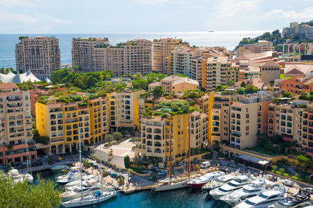 Monaco, Monte Carlo - September 16, 2016: Principality of Monaco. View of the seaport and the city of Monte Carlo with luxury yachts and sail boats Monaco, Monte Carlo - September 16, 2016: Sunset in Principality of Monaco. View of the seaport and the cit