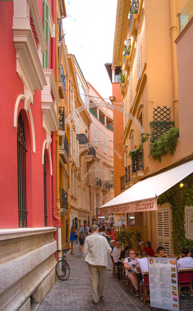 mediterranian houses: Monaco, Monte Carlo - September 16, 2016: Rock of Monaco.  Rue Comte Félix Gastaldi the street with restaurants and cafes with people ant tourists. The street leads to the palace of Monaco. Editorial