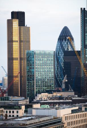 London, UK - December 19, 2016: City of London business aria view at sunset. View includes Gherkin building. City of London the leading financial centre in the Europe.