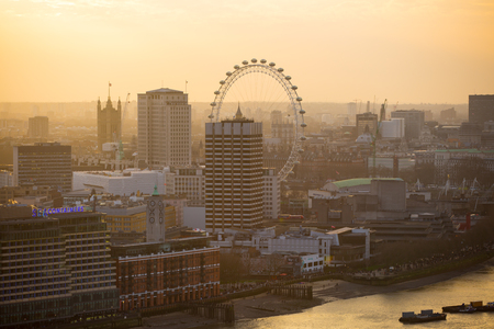 st pauls: London, UK - December 19, 2016: London at sunset, view from the St. Pauls cathedral. Panoramic view includes London eye, river Thames and embankment Editorial