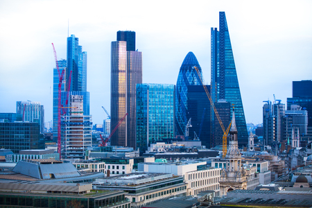 sunset city: London, UK - December 19, 2016: City of London business aria view at sunset. City of London the leading financial centre in the Europe.