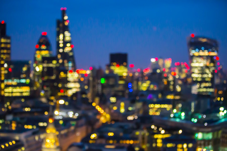 arhitecture: City of London at sunset with lights and reflection. View at the business and banking aria with modern skyscrapers. Blurred image for background