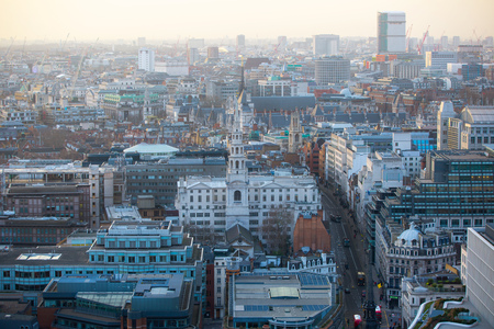 London, UK - December 19, 2016: City of London office blocks at sunset and Bank street aerial view