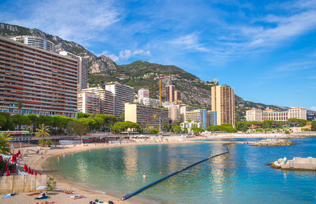 Monaco, Monte Carlo - September 17, 2016: Page du Lavotto, the only public beach of Monaco with people relaxing by the sea. Editorial