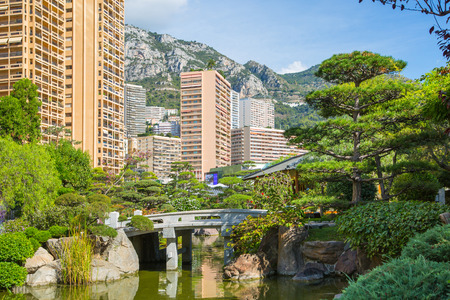 Monaco, Monte Carlo - September 17, 2016:  Jardin Japonais, Japanese Garden view with residential buildings at the background. Monaco, Monte Carlo