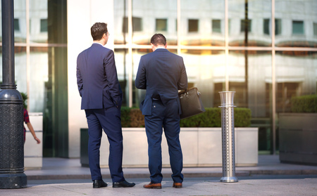 business life: London, UK - 8 September, 2016: Business people walking on the Canary Wharf square, business and financial aria. Modern life concept