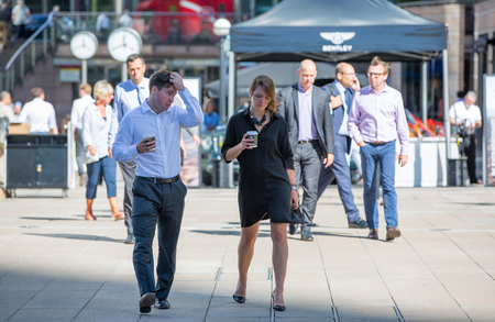 business life: London, UK - 8 September, 2016: Canary Wharf business people going to work. Modern life concept Editorial