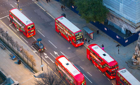 st pauls: London, UK - 19 December, 2016: London at night, view from st. Pauls cathedral. Streets of financial aria City of London with red double decker buses. Editorial