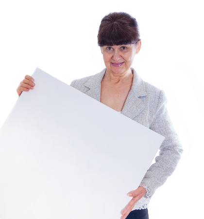 Mature woman leaning on white banner. Portrait against of white background
