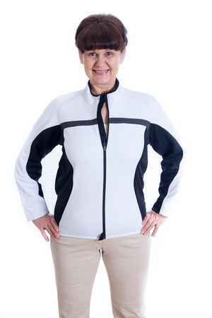 Happy pension age good looking woman in sport outfit against of white background Stock Photo