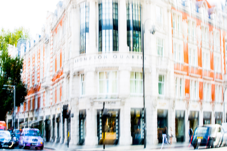knightsbridge: LONDON, UK - SEPTEMBER 8, 2016: Blurred image. Period apartment  building on the  Brompton road in Khightsbridge. Editorial