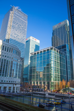 London, UK - November 30, 2016: Canary Wharf business and banking aria at sunny day. Main square view with glass skyscrapers