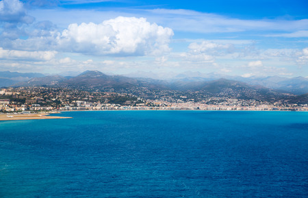 Nice, France - September 15, 2016: panoramic view of Nice airport against of mountains and cloudy sky. The cote dazur landscape