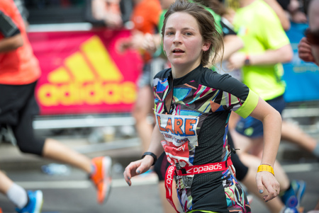 London, UK - April 23, 2017:  Attractive young woman running London Marathon. Editorial