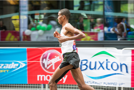 London, UK - April 23, 2017: London Marathon. Professional sprinter arriving the first in Canary Wharf. Editorial