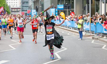 London, UK - April 23, 2017: Happy Marathon runner cheering by public. Charity money raise.