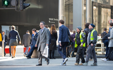 business life: London, UK - March 15, 2017: Group of business people walking  in the City of London. Modern busy business life Editorial