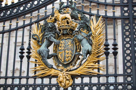 royal: London, UK - October 4, 2016: Gate design of main entrance Buckingham Palace the official residence of Queen Elizabeth II. Editorial