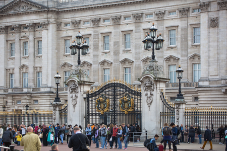 royal: London, UK - October 4, 2016: Buckingham Palace the official residence of Queen Elizabeth II and one of the major tourist destinations U.K. View from the park