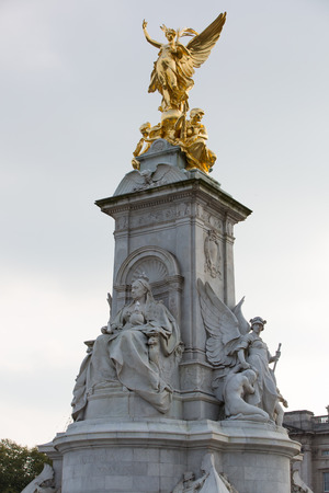 London, UK - October 4, 2016:  The Victoria Memorial is a sculpture dedicated to Queen Victoria, created by Sir Thomas Brock. Placed at the centre of Queens Gardens in front of Buckingham Palace.