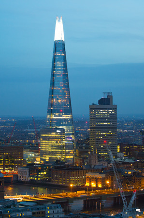 shard: London, UK - December 19, 2016: Shard of Glass and London bridge at night. London at sunset