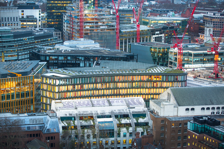 London, UK - December 19, 2016: City of London business aria view at dusk. Office buildings