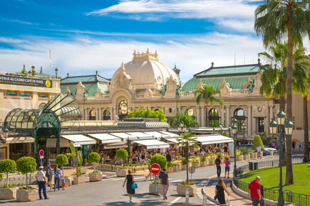 Monaco, Monte Carlo - September 17, 2016: The Grand casino Monte Carlo and cafe with lots of people chilling out in hot a sunny day