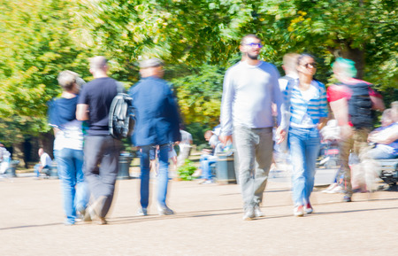 knightsbridge: London, UK - September 8, 2016:  Blurred image of walking people in the park