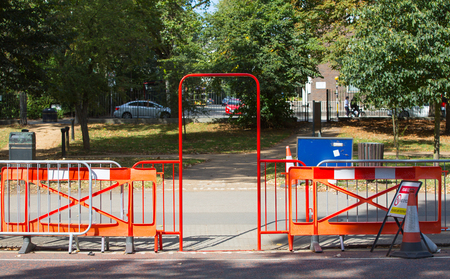 Red barrier and gate blocking the restricted aria in park, London Stock Photo